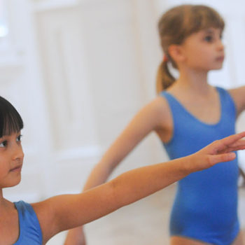 Two school girls practicing ballet