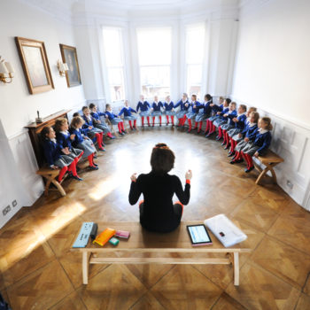 Group of school girls getting taught