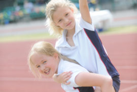 Two girls celebrating on the track