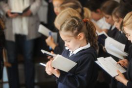 Young school girl reading