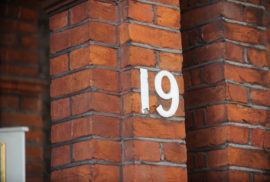 Closeup shot of wall with number nineteen