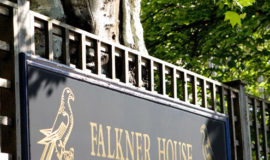 Closeup shot of gate with falkner house logo